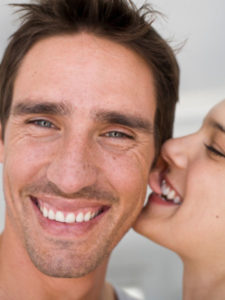 Woman Nibbles on Man's Ear