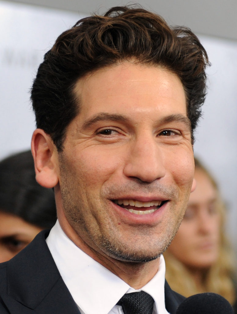 "Actor Jon Bernthal, who plays the part of ""Coon-Ass/Grady Travis, gives interviews with the media on the ""Red Carpet"" during the world premiere of the movie Fury at the Newseum in Washington D.C. (Department of Defense photo by Marvin Lynchard)"